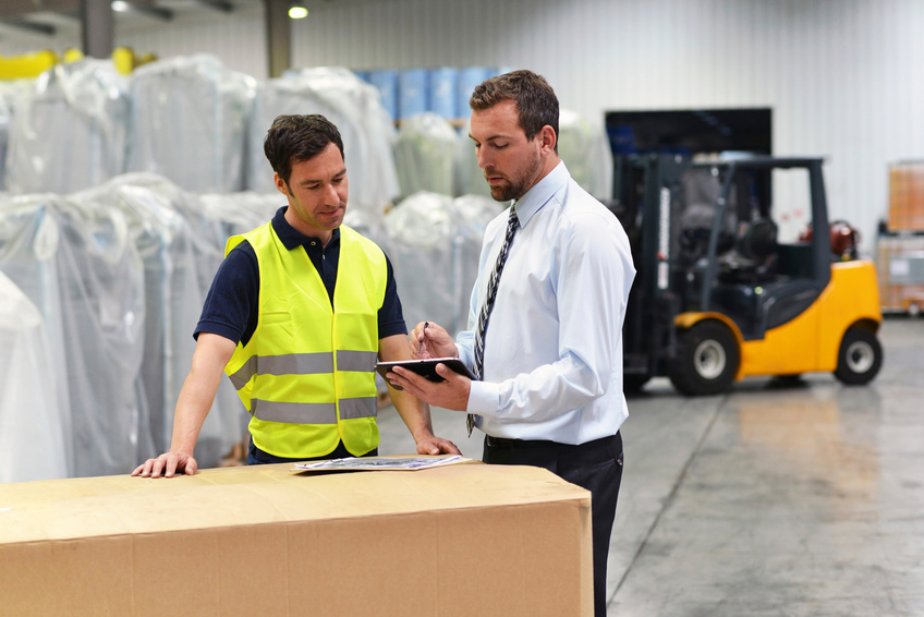 Manager of a logistics company are working instruction of skilled workers, Saxony-Anhalt, Germany